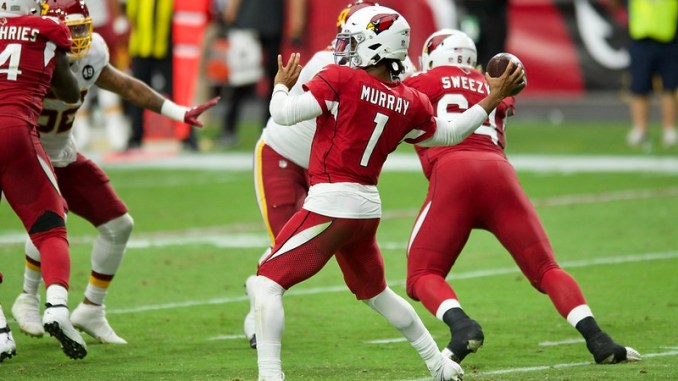 NFL Arizona Cardinal quarterback Kyler Murray attempting a pass against the Washington Football Team