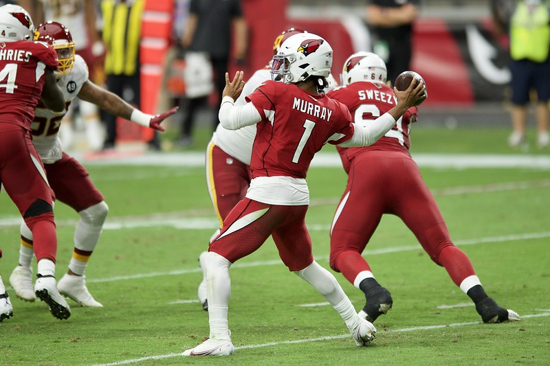 NFL Arizona Cardinal quarterback Kyler Murray attempting a pass against the Washington Football Team