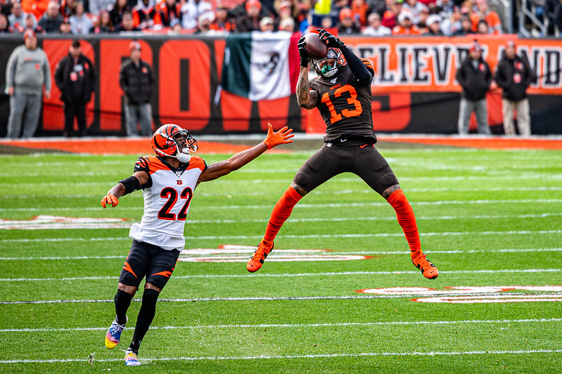 NFL Cleveland Browns wide receiver Odell Beckham Jr. catching a pass against a Cincinnati Bengals defender