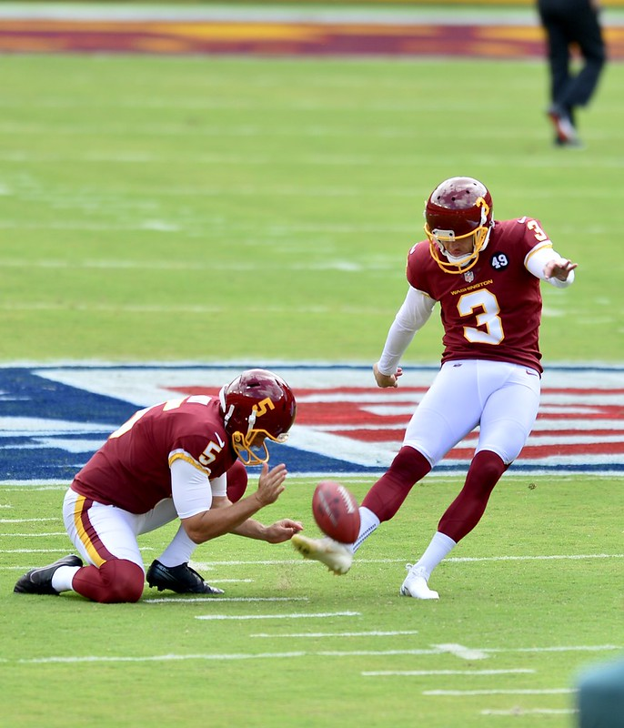 NFL Washington Football Team kicker Dustin Hopkins attempting a field goal