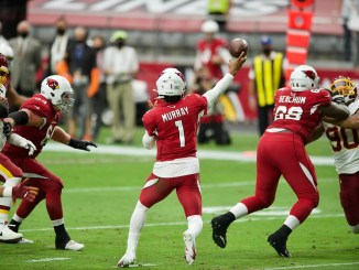 Arizona Cardinals quarterback Kyler Murray throwing a pass in a football game