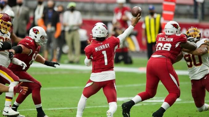 Arizona Cardinals quarterback Kyler Murray throwing a pass in a football game
