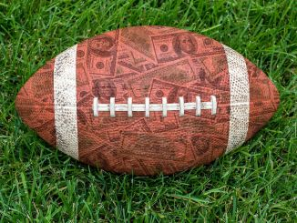 Football with a money design on it