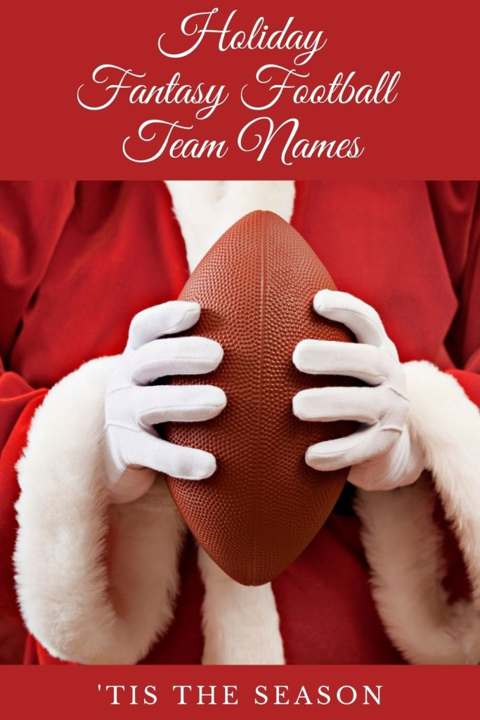 Santa holding an American football with two hands in white gloves.