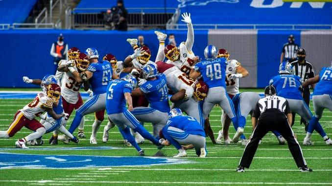 Detroit Lions Matt Prater kicking a field goal against the Washington Football Team in Ford Field