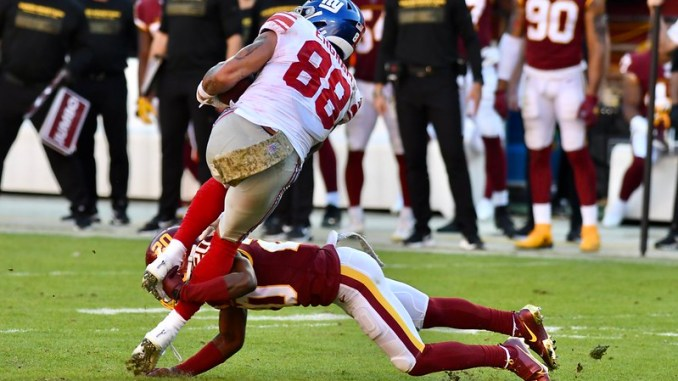 New York Giants tight end Evan Ingram getting tackled by a Washington Football Team defender