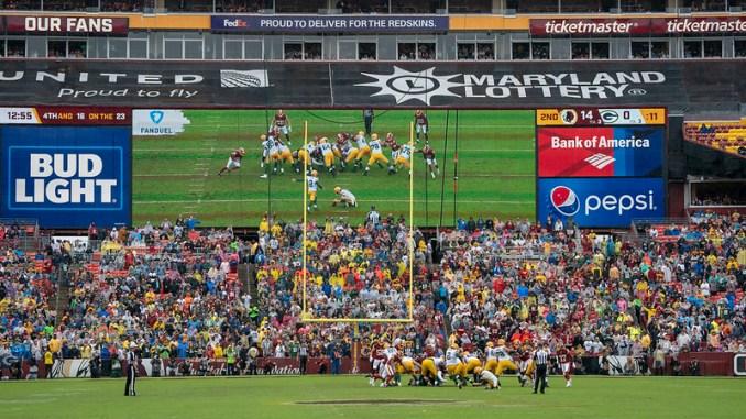 NFL Green Bay Packers kicker Mason Crosby attempting a field goal.