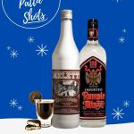 A dark brown chocolate Peppermint Pattie Shot. Garnished with a Peppermint Pattie candy on the side of a shot glass. Sitting next to a bottle of Meletti Cioccolato Liqueur and a bottle of Rumple MInze in a snow cartoon background.