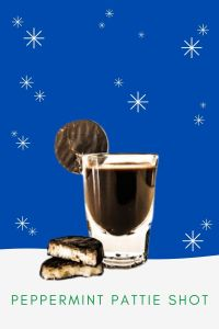 A dark brown chocolate Peppermint Pattie Shot made with Meletti Cioccolato Liqueur and Rumple MInze. Then garnished with a Peppermint Pattie candy on the side of a shot glass sitting in a snow cartoon background.