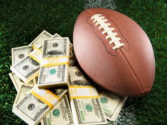 American Football Pile of Cash on Grassy Field