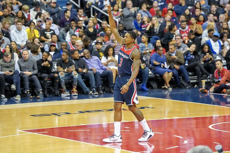 NBA Washington Wizards shooting guard Bradley Beal with his arm raised in a basketball game against the Toronto Raptors.