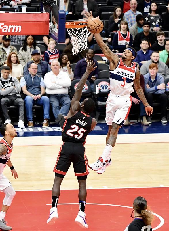 NBA Washington Wizards shooting guard Bradley Beal blocking a Miami Heat players shot.