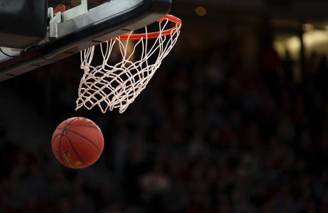 A basketball swishing through the net.