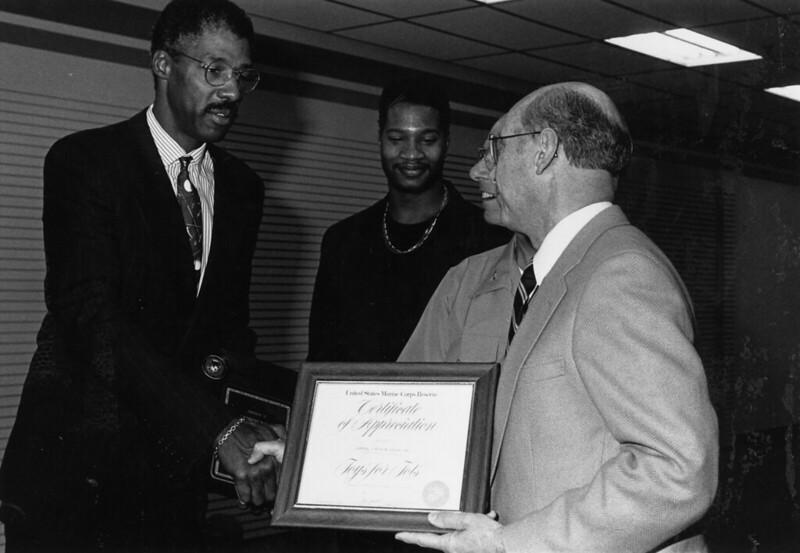 Legendary NBA players small forward Julius Erving accepting an award.