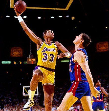 "NBA Los Angeles Lakers legend center Kareem Abdul-Jabbar shooting his trademark ""skyhook"" in a basketball game."