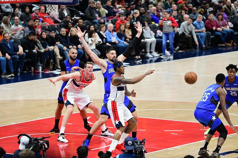 Orlando Magic center Nikola Vucevic playing defense against the Washington Wizards.