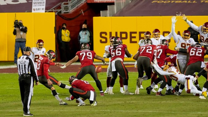 Tampa Bay Buccaneers kicker Ryan Succop kicking a field goal agasint the Washington Football Team in the playoffs.