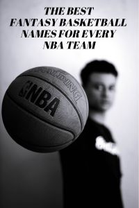 Grayscale photo of man holding NBA basketball.