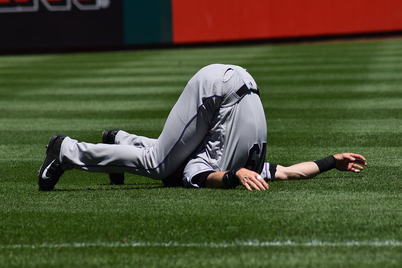 Colorado Rockies right fielder Charlie Blackmon stretching before a baseball game.