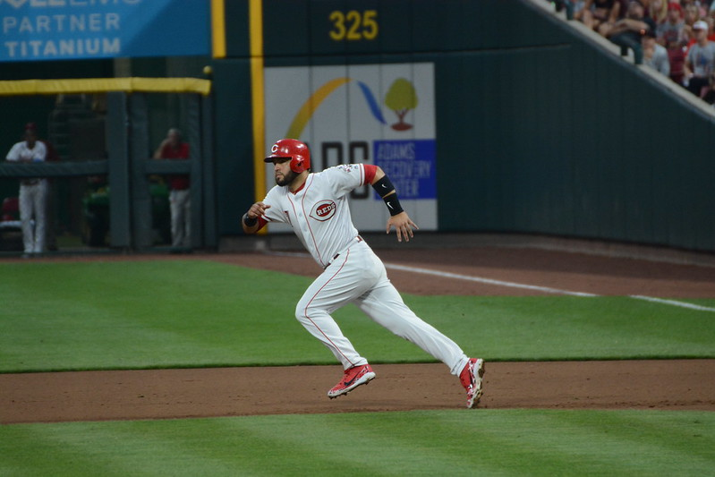 MLB Cincinnati Reds shortstop Eugenio Suarez running between bases.