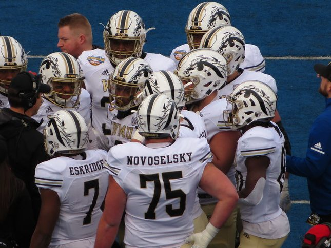 Former Western Michigan University wide receiver D'Wayne Eskridge in a team huddle at the Idaho Potato Bowl Game.