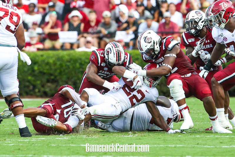 The University of Alabama running back Najee Harris getting tackled by University of South Carolina defenders.