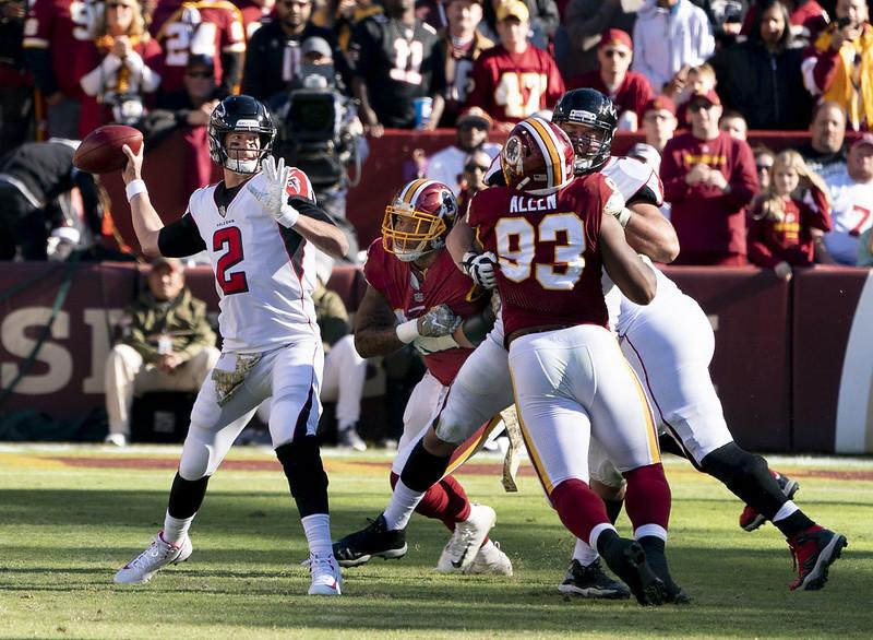 Atlanta Falcons quarterback Matt Ryan throwing the football against the Washington Football Team defense.