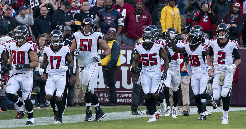 The NFL Atlanta Falcons running on to the football field.