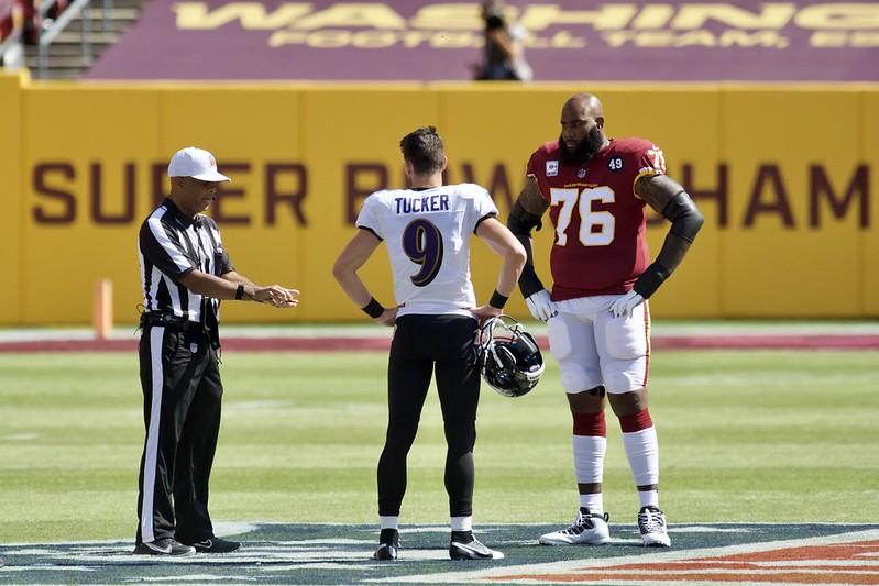 Baltimore Ravens kicker Justin Tucker calling the coin flip against the Washington Football Team.