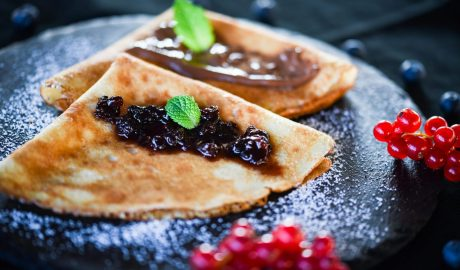 delicious home made pancakes with fresh fruits & chocolate