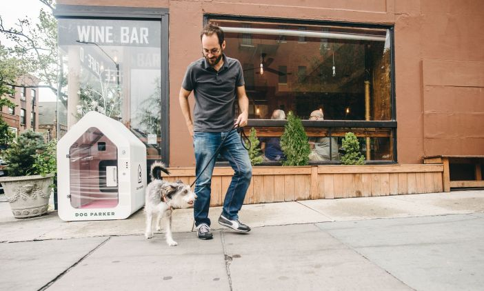 Man with dog stops at Dog Parker in Brooklyn, New York.