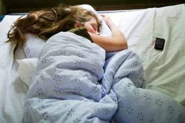 Here's why sleeping with your phone in bed can affect your health