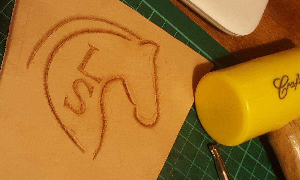 Hand Tooled Lady Saddler Logo