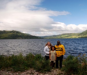 Jessica and her family on Loch Ness, across from Urquhart Castle