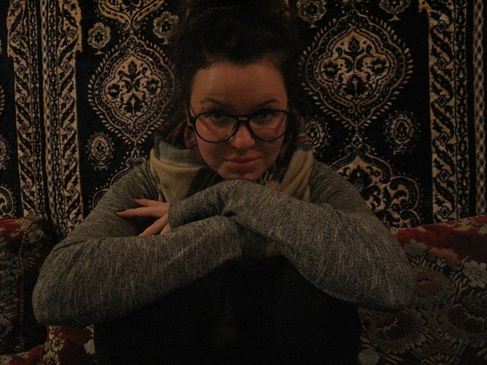 Me, trying to chameleonize with the traditional Moroccan wall carpet