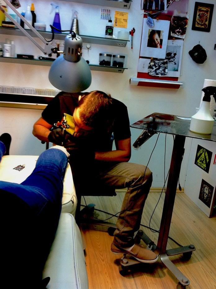 Getting tattooed