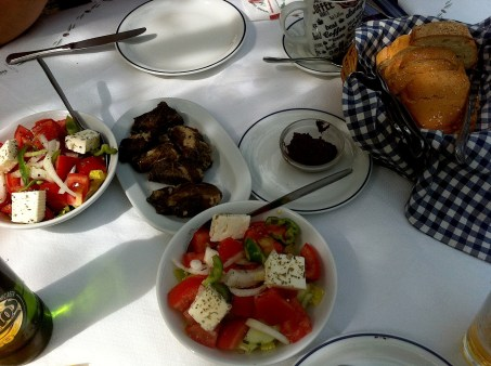Greek salads and Dolmathakia - stuffed grape leaves with rice and herbs