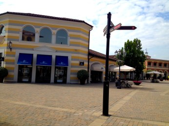 Inside on of designer outlet villages, located close to Milan