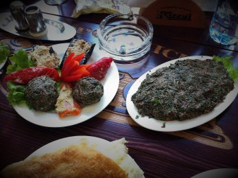 Mkhali - cold dish with spinach leaves and walnuts.
