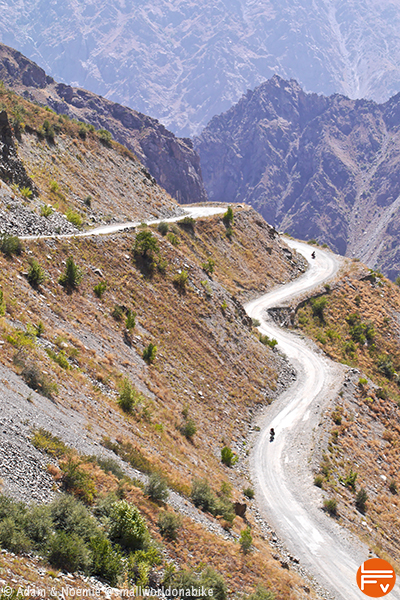 two riders on a downhill - Pamir Highway