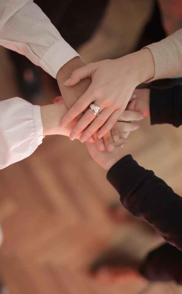 crop friends stacking hands together