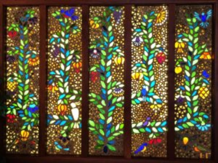 The Tree of Life Stained Glass by Fayetteville Native, Elizabeth Grafton is tucked away in United Bank.