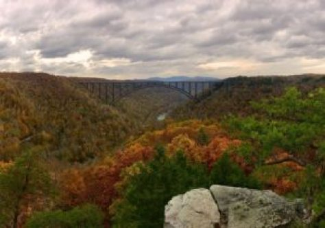 Autumn view of the New River Gorge Bridge from the Long Point Trail.