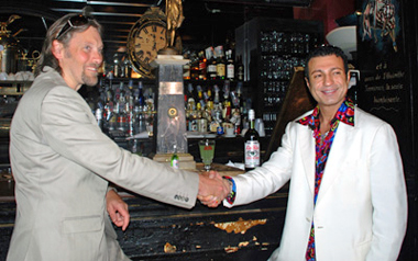 George Rowley shaking hands with owner of Old Absinthe House New Orleans