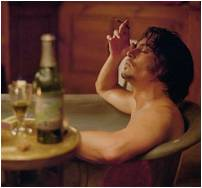 Johnny Depp in bath with glass and bottle of absinthe