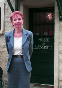 Marie-Claude Delahaye at door of Musée de l'absinthe