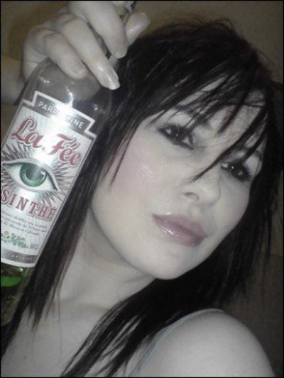 Girl holding bottle of La Fée absinthe