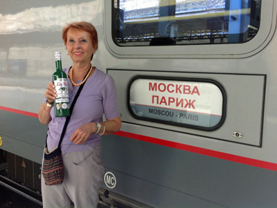 Marie-Claude Delahaye with bottle of La Fée absinthe outside Trans Siberian Express
