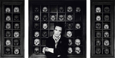 Sebastion Horsley with shelving containg skulls