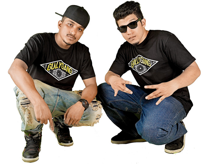 The rappers Divine and Naezy